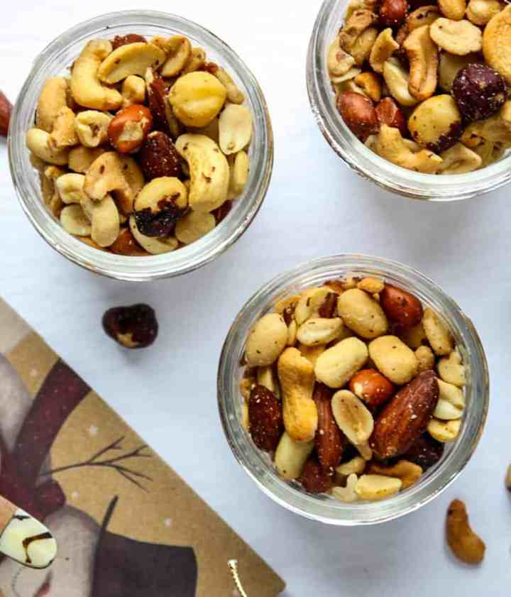 Three jars of mixed nuts on a plate