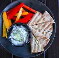 A bowl of food, with Tzatziki