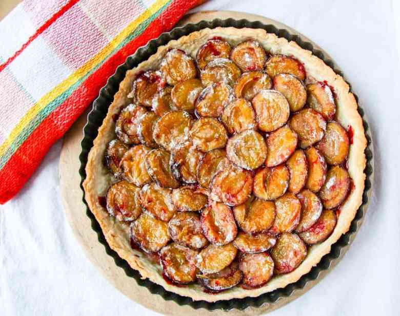 A plum tart on a table