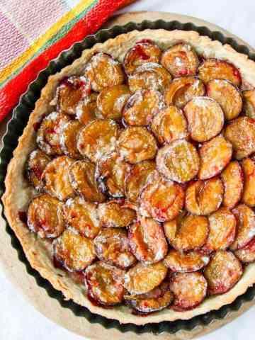 A plum tart on a table