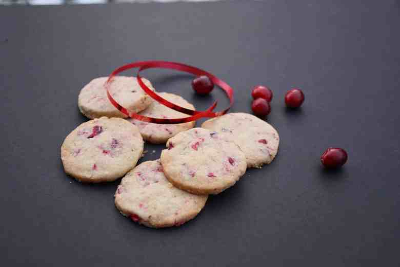Cookies on a table with cranberries