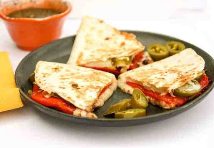 A plate of food on a table, with Quesadilla and Cheese