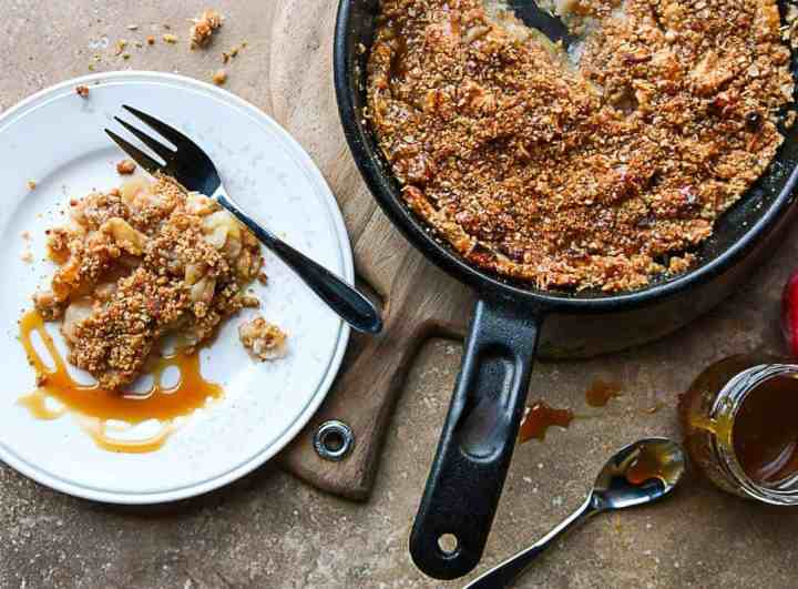 A pan of food on a table, with Apple crisp