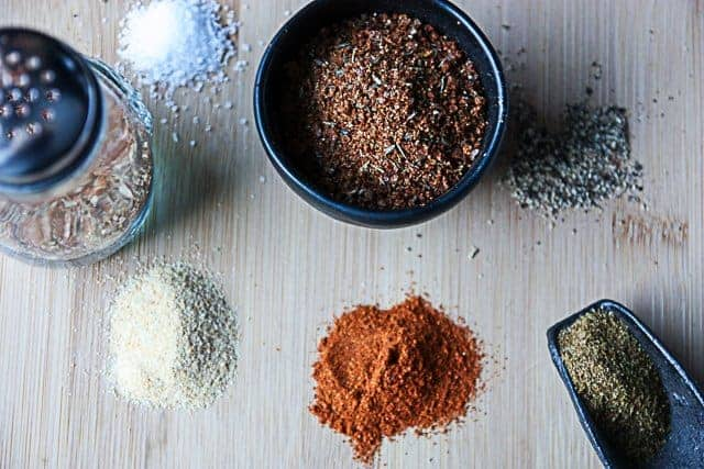 A dish of blended spices on a cutting board