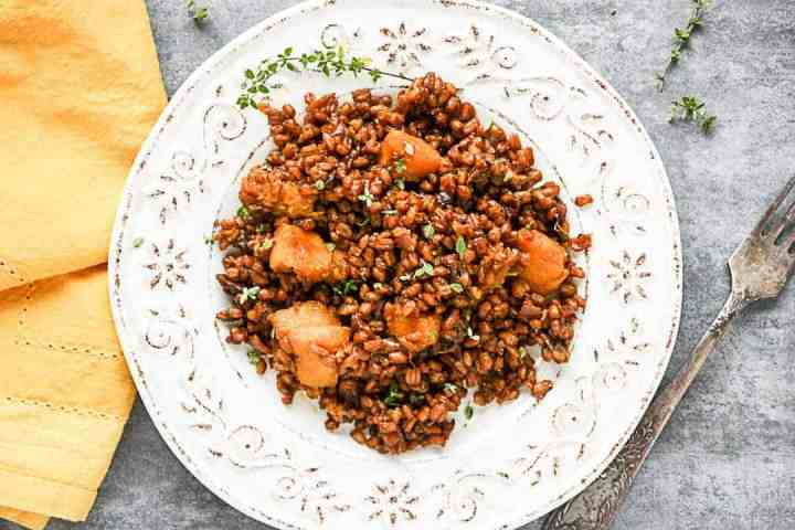 A plate of food on a table, with Farro