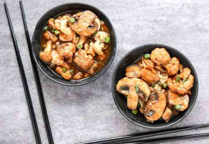 Two bowls of Mushrooms and cauliflower in sauce