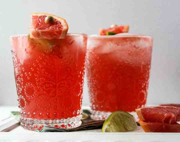 Two drinks in glasses with ice and Grapefruit juice