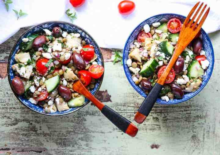 Two bowls of salad on a table