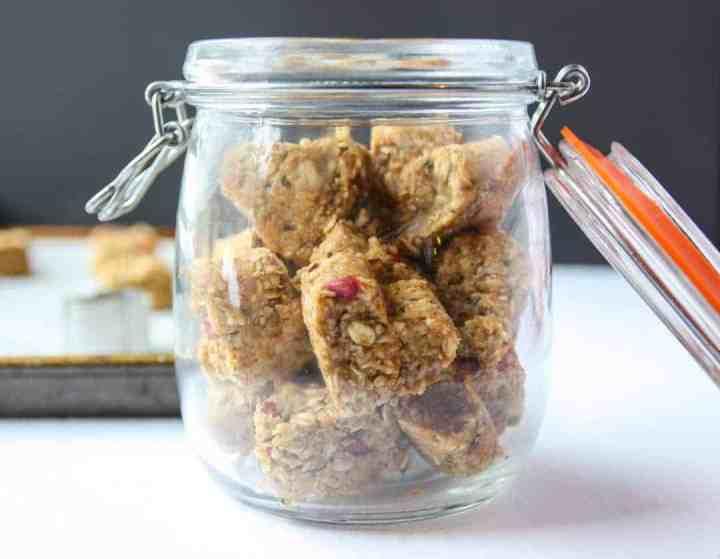 Glass jar full of heart shaped oatmeal energy bites