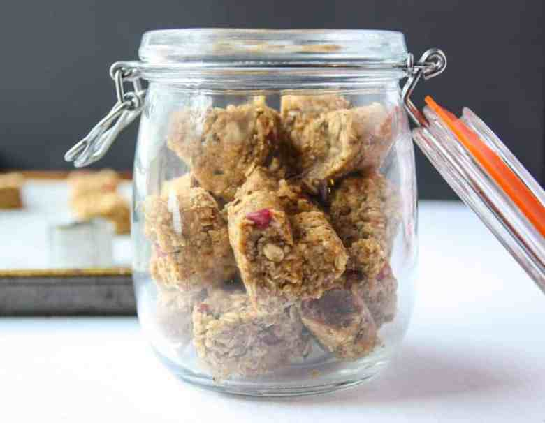 Glass jar full of heart shaped oatmeal energy bites