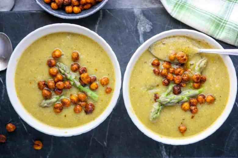 Two bowls of soup on a table