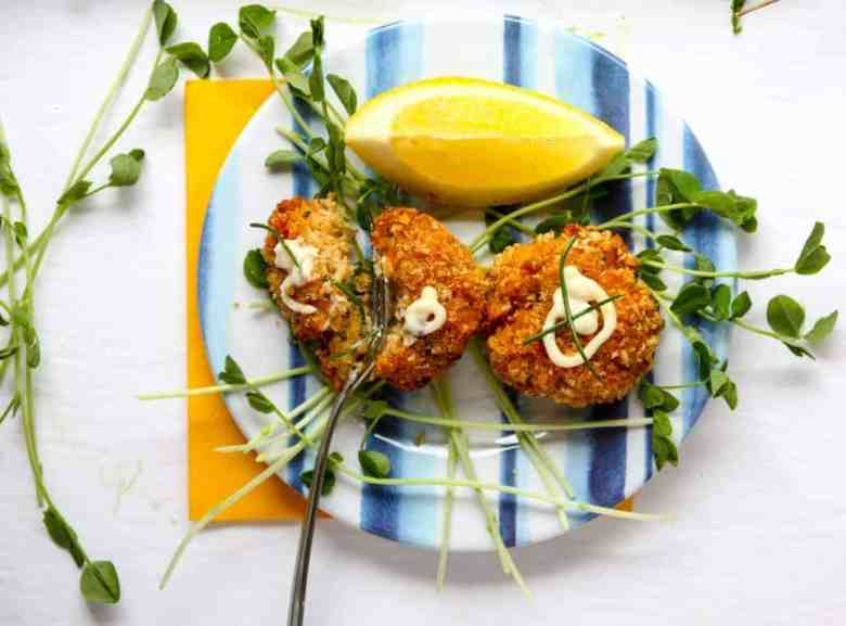 A plate of food on a table, with Crab cake and Aioli