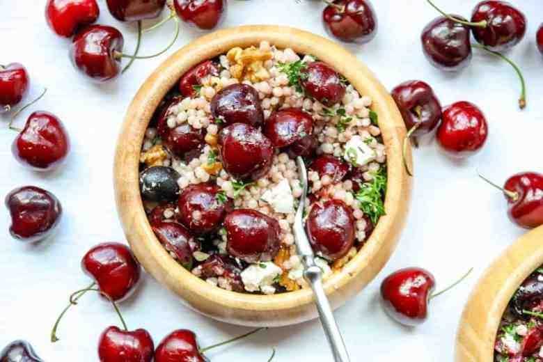 Salad with cherries in a wooden bowl