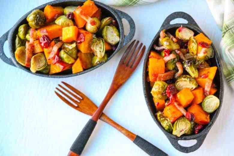Two plates of Brussels sprouts and Butternut squash