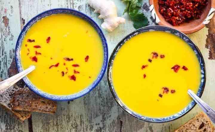 Two bowls of Ginger Lentil Carrot soup