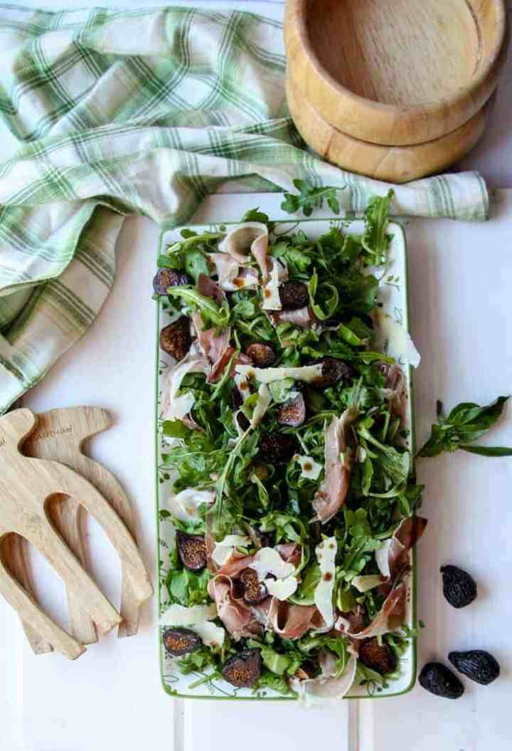Platter of Fig Salad with wooden salad bowls and tongs