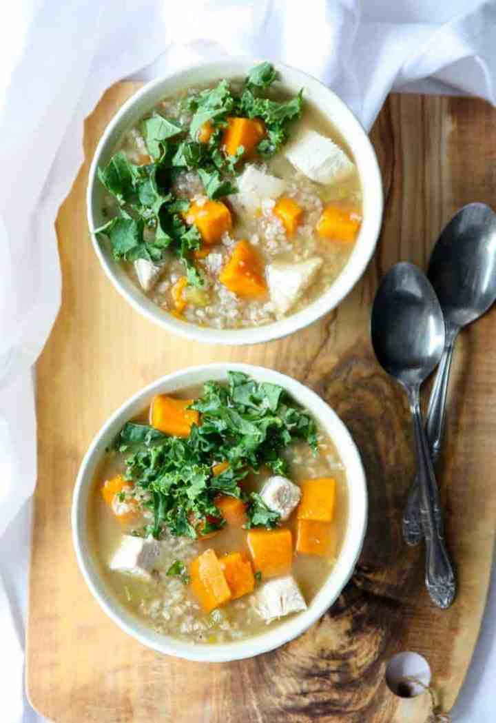 Two bowls of turkey buckwheat soup with kale and sweet potatoes