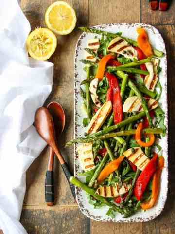 Platter of roasted peppers, asparagus, and cheese.