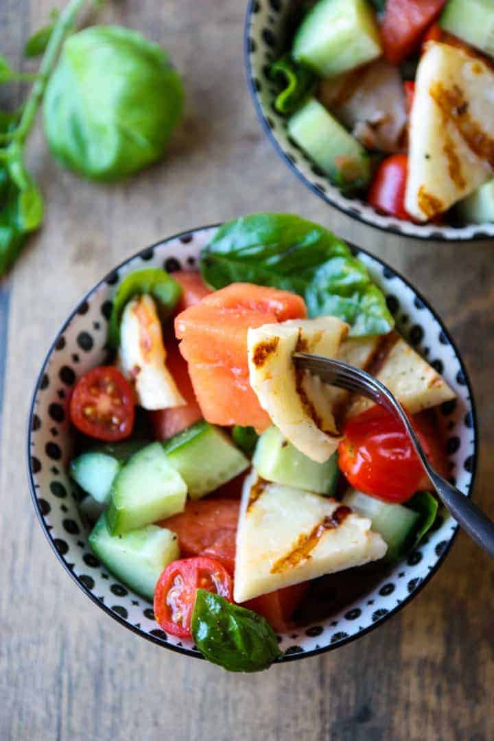 Grilled halloumi & watermelon salad in a black & white bowl
