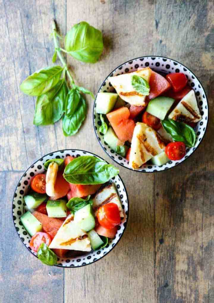 A bowl of fruit and vegetable salad, with Halloumi and Cheese