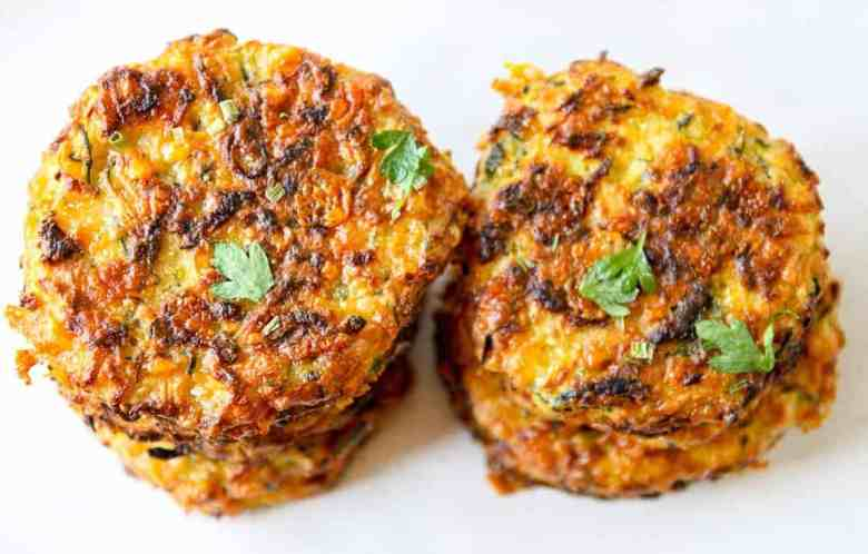 top down view of two stacks of baked zucchini fritters