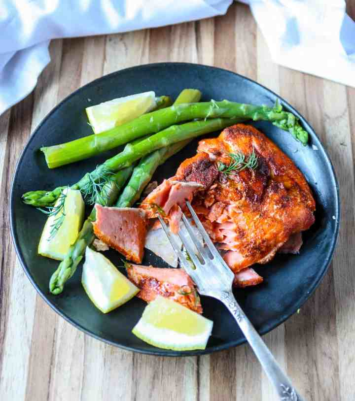 A plate with salmon and asparagus.