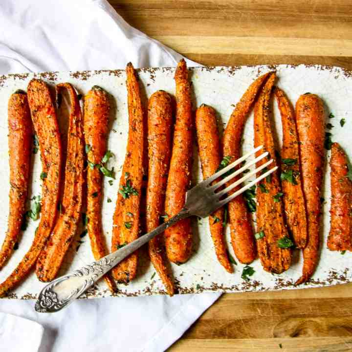 Air Fried Carrots on a white plate with a fork.