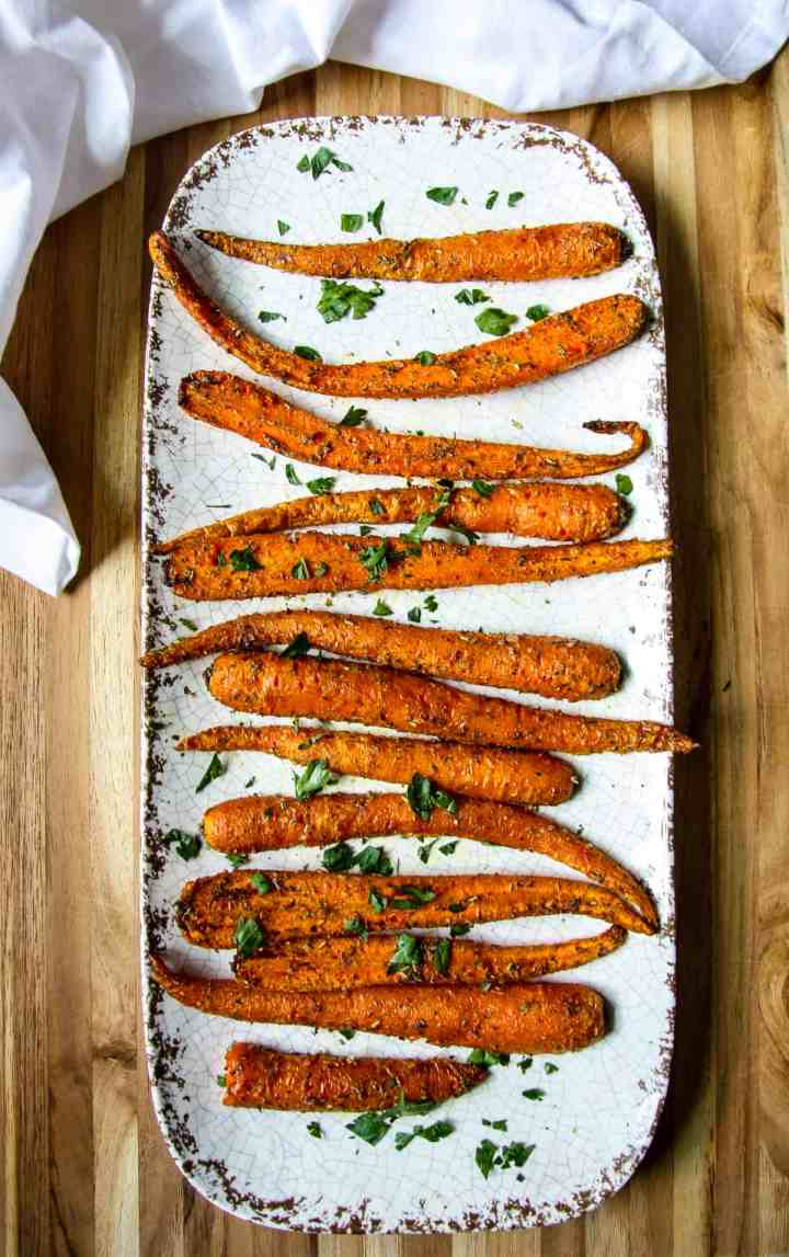 Air fried carrots on white plate.