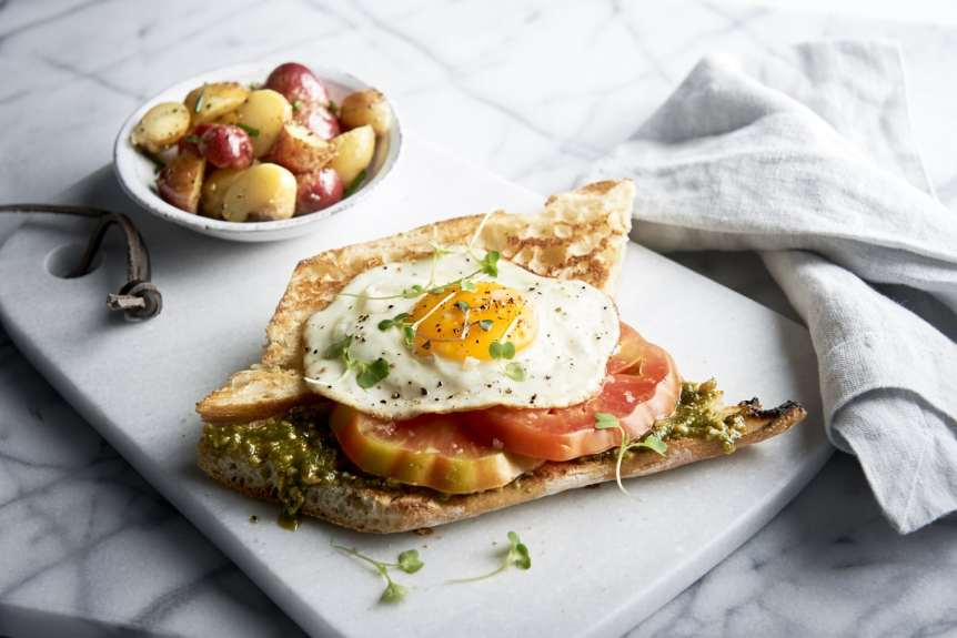 Ralph Smith Savory Food Beverage Photography, breakfast sandwich, roasted potatoes, egg, heirloom tomatoes, toast, jam, food photography, brunch, commercial advertising
