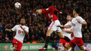 Manchester United's Swedish striker Zlatan Ibrahimovic (2nd L) jumps to head their third goal during the English League Cup final football match between Manchester United and Southampton at Wembley stadium