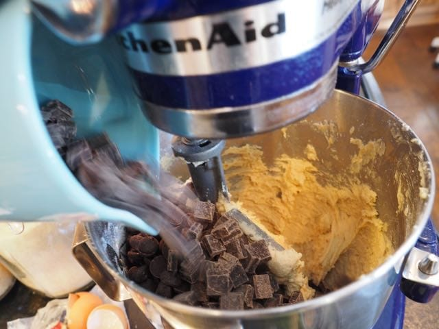 Pouring in chips and chunks for chocolate chip cookies | www.thefreshcooky.com