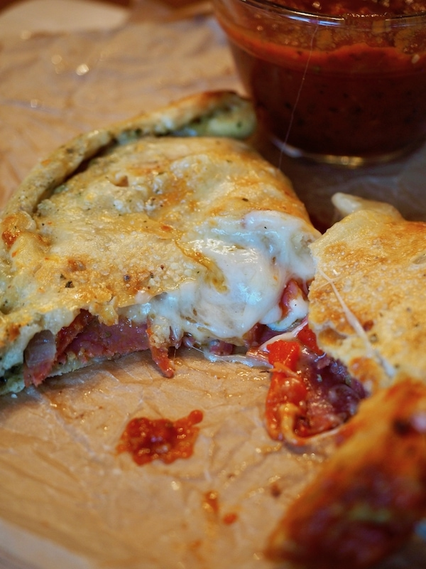 Calzones, inside out pizzas, completely custom, fill them with what you and your family love! Stuff with Pesto, pepperoni, Italian sausage, peppers and onions, artichoke hearts, ricotta and mozzarella cheeses, create your own! A great easy, weeknight meal and alternative to pizza. #thefreshcooky #calzones #meat #vegtarian #pizza #easyweeknightmeal