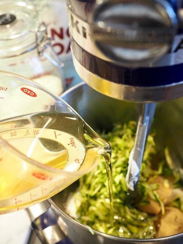 adding oil to chocolate zucchini cake batter | www.thefreshcooky.com