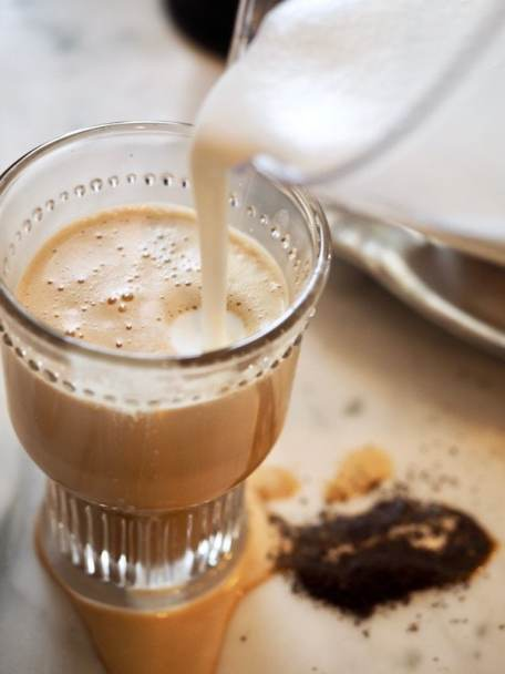 Pouring on frothed cream for Bulletproof Coffee | www.thefreshcooky.com