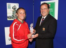 Ashleigh Baxter receives the Ulster Women's Player of the Year Award from Johnnie Neary.