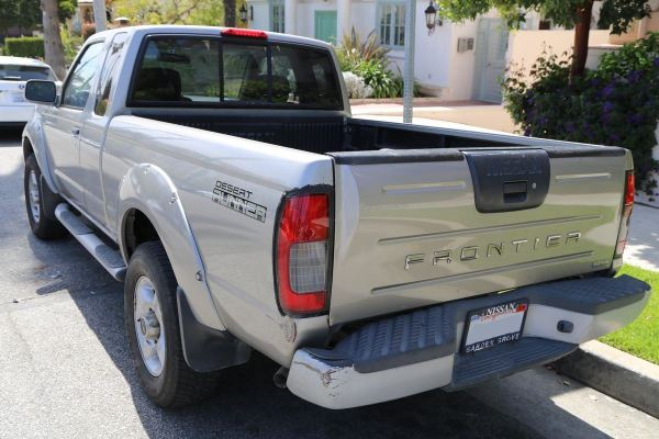 Photo of our truck showing dent in rear bumper and scratches