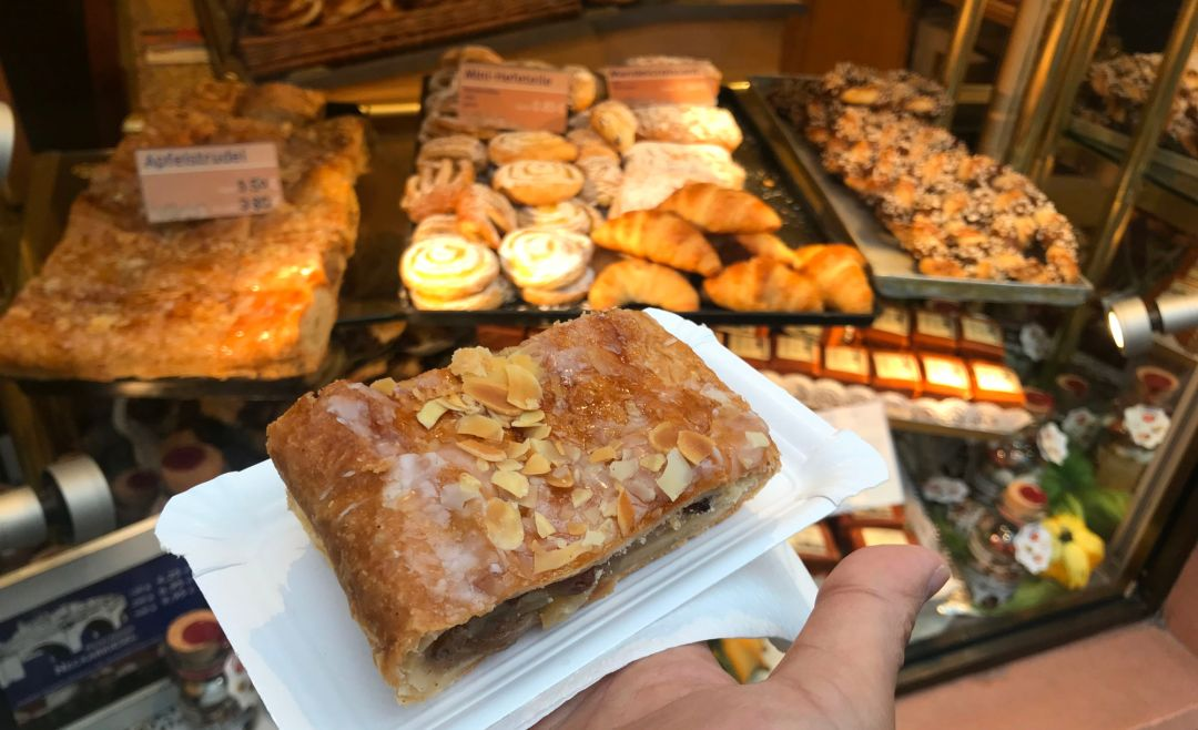 Apple strudel with amazing pastries in the background