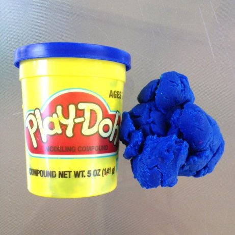 blue play doh beside the play doh container