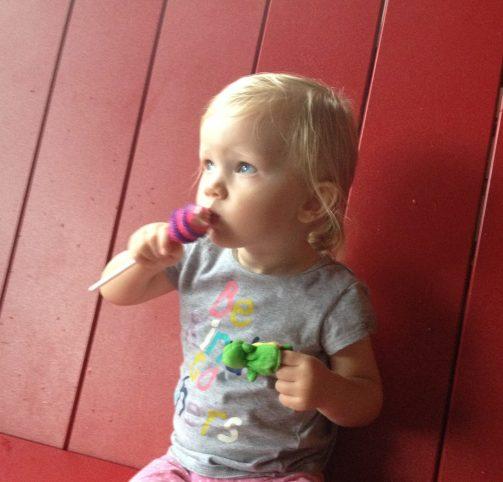 little girl enjoying marshmallow treat