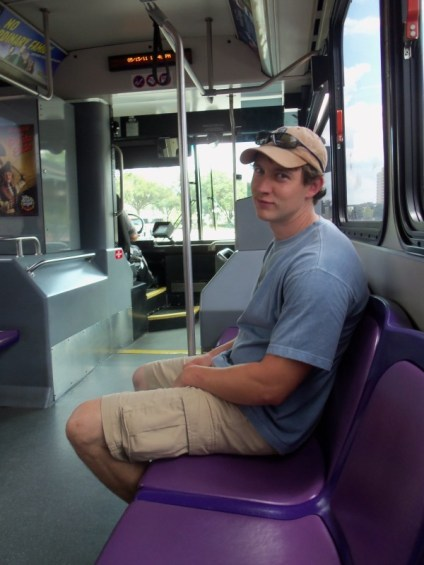 man riding disney's bus transportation
