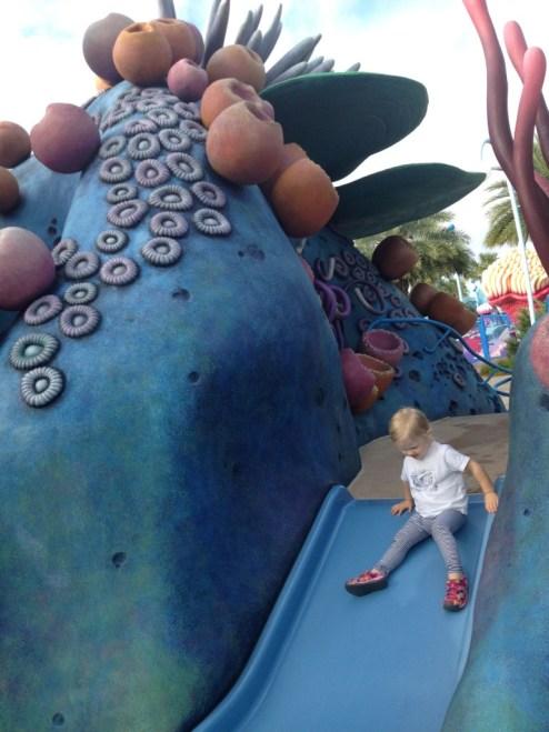 little girl enjoying the slide at art of animation