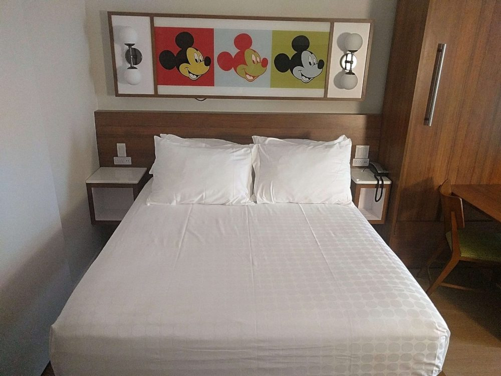 mickey themed room with white bed