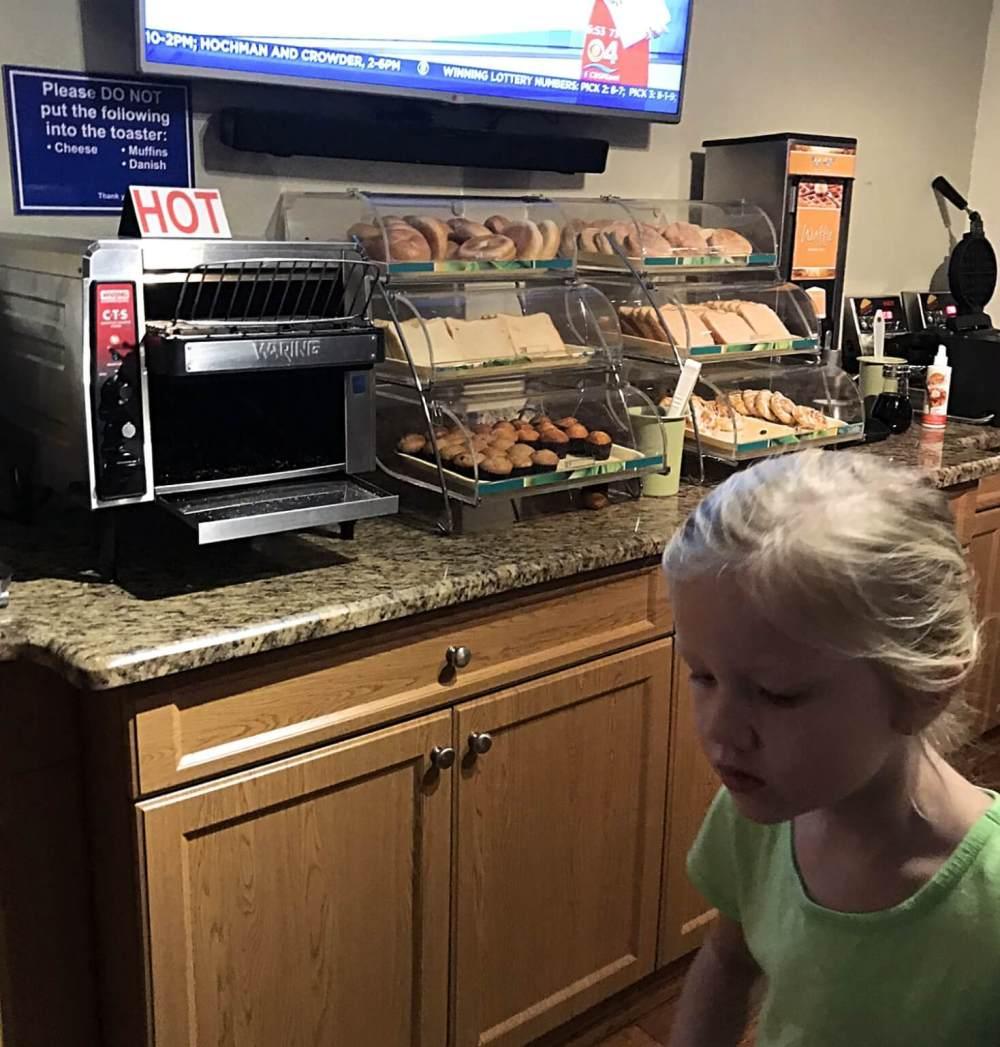 little girl getting a hotel breakfast