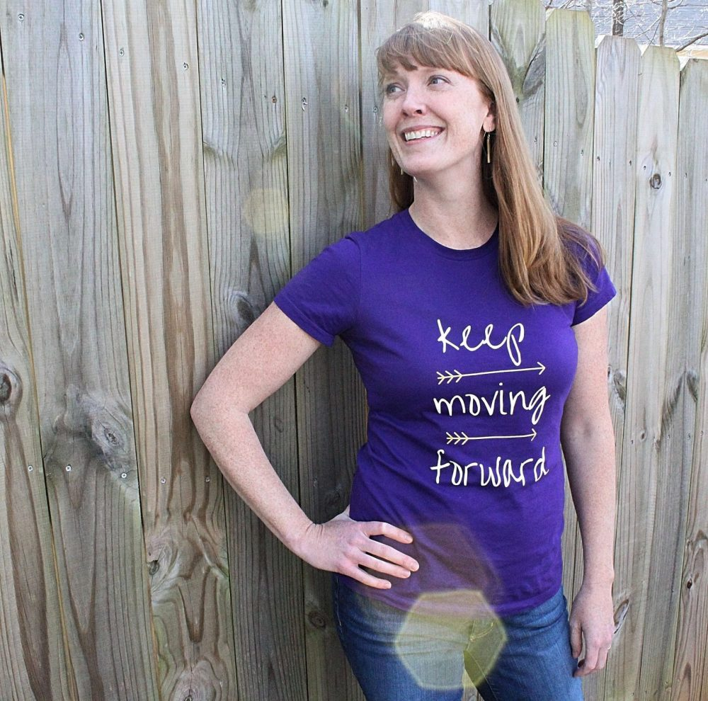 Woman wearing a Keep Moving Forward Arrow T-shirt