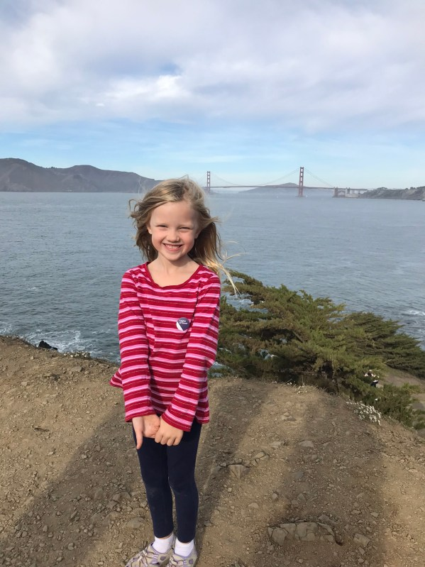 little girl with golden gate bridge in background