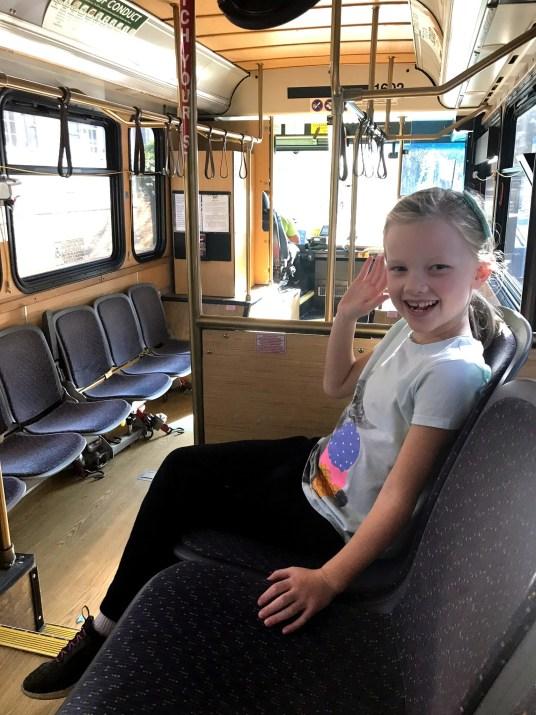 girl riding trolley bus in savannah