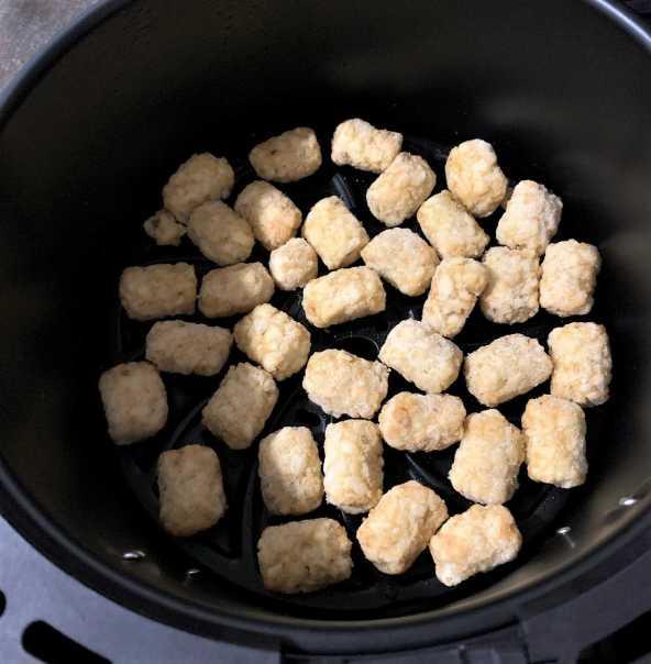 frozen tator tots in an air fryer basket
