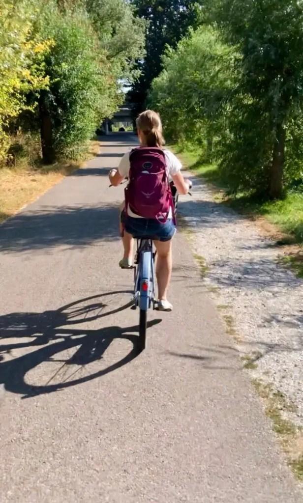 Gwen biking to the Zaanse Schans windmills on a beautiful day.