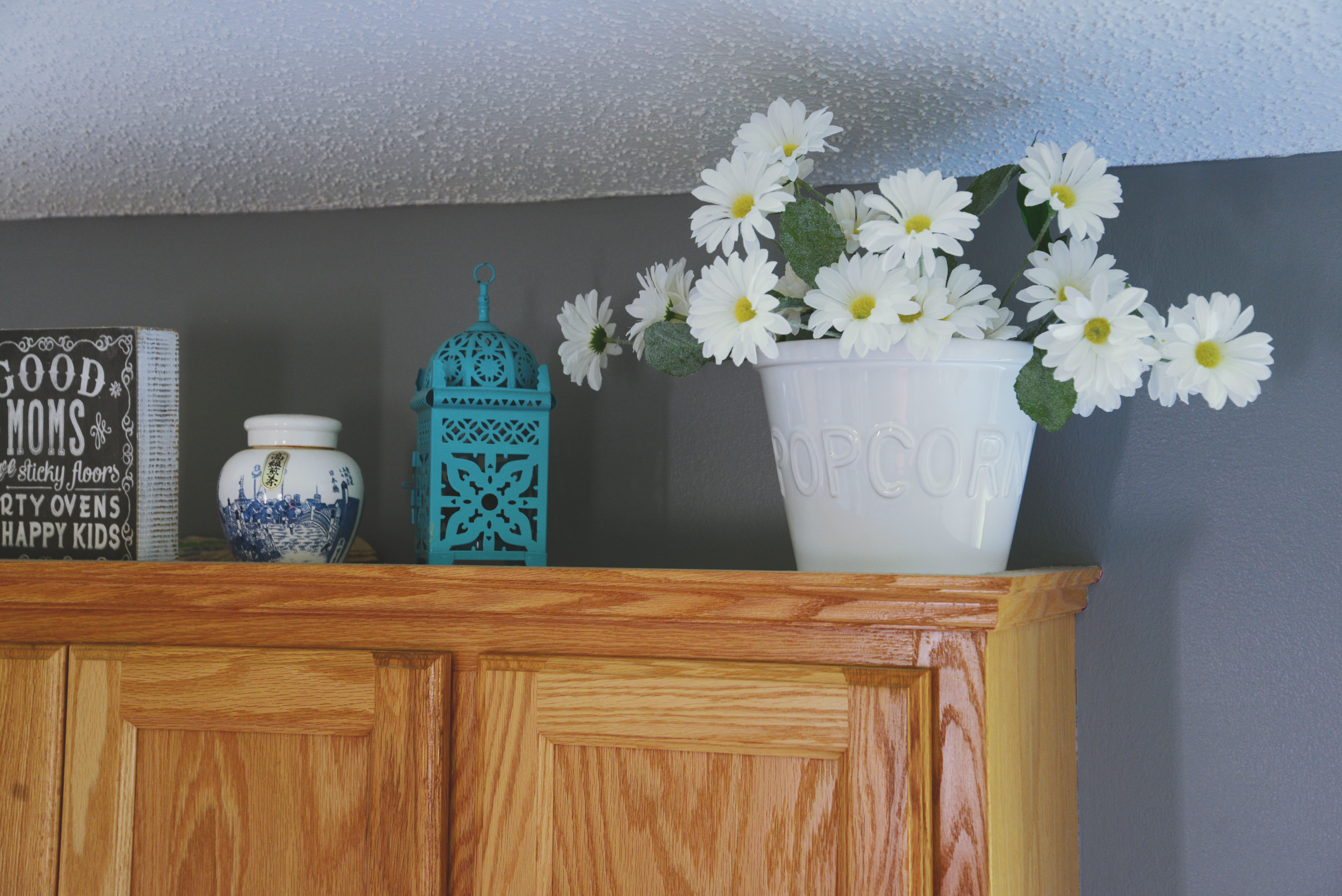 faux flowers, small house, faux flower decorations, decorating with faux flowers, how to make a small space bigger, small home, make a small home bigger, bright up a small house, hide outlets,