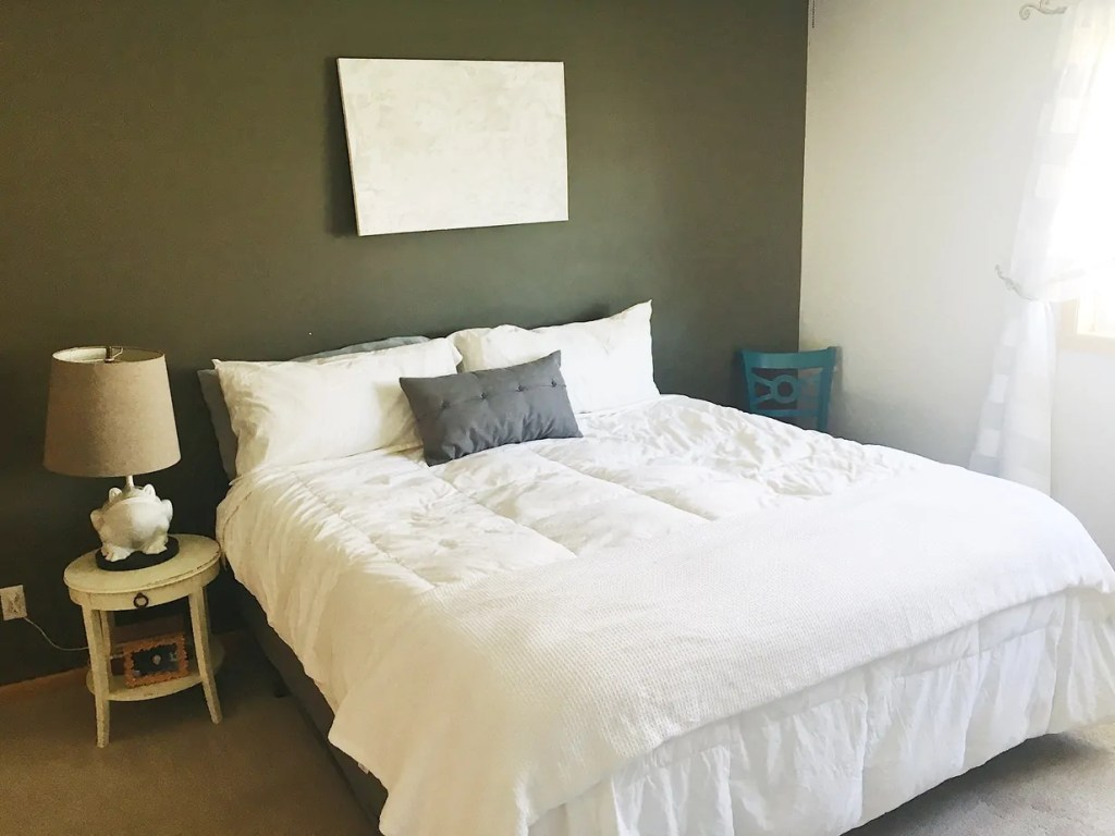 We gave our small master bedroom a makeoer on a $200 budget! Here are 10 tips to help you create a peaceful master bedroom without breaking the bank!